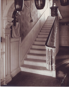 First-floor entryway with fire buckets and carved newel post